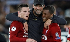 Soccer Football - Champions League - Group Stage - Group C - Liverpool v Paris St Germain - Anfield, Liverpool, Britain - September 18, 2018 Liverpool's Andrew Robertson and Georginio Wijnaldum celebrate with manager Juergen Klopp after the match REUTERS/