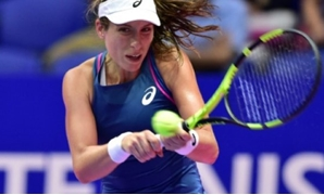 © AFP | Britain's Johanna Konta returns a shot against Canada's Gabriela Dabrowski