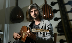 Belgian musician Tristan Driessens is one of the West's few masters of the oud, the oriental lute, and now works with refugees to preserve and develop their musical culture in their new host country-AFP / JOHN THYS