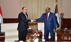 File - President Abdel Fatah al-Sisi and his Sudanese counterpart President Omar Bashir in Khartoum on July 19, 2018