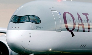 FILE - Qatar Airways said Tuesday, Sept. 18, 2018 that it suffered a loss of $69 million this year off revenue of $11.5 billion amid a boycott of Doha by four Arab nations. (AP Photo/Michael Probst, File)