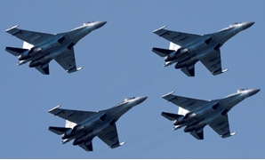 FILE PHOTO: Sukhoi Su-35 multi-role fighters of the Sokoly Rossii (Falcons of Russia) aerobatic team fly in formation during a demonstration flight at the MAKS 2017 air show in Zhukovsky, outside Moscow, Russia, July 21, 2017. REUTERS/Sergei Karpukhin/Fil