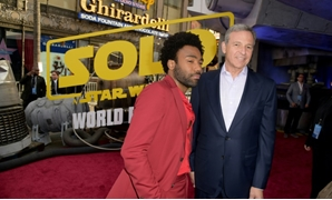 "Disney CEO Bob Iger -- shown here with ""Solo: A Star Wars Story"" star Donald Glover at the film's Hollywood premiere in May 2018 -- has said it will slow down its release schedule for the franchise."