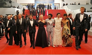 "71st Cannes Film Festival - Screening of the film ""Solo: A Star Wars Story"" out of competition - Red Carpet - Cannes, France May 15, 2018. Director Ron Howard poses with cast members Joonas Suotamo, Thandie Newton, Woody Harrelson, Emilia Clarke, Alden Eh"