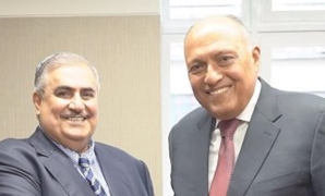 Egyptian Foreign Minister Sameh Shoukry with his Bahraini counterpart Sheikh Khalid bin Ahmed Al-Khalifa on the sidelines of the UN General Assembly meetings in New York City - Press Photo