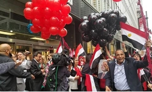Egyptians in New York welcome President Sisi and chant for him - Press photo