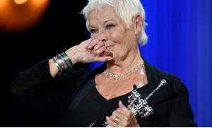 Judi Dench receives a lifetime achievement award at the San Sebastian Film Festival on Tuesday-AFP / ANDER GILLENEA