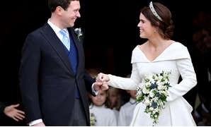 Britain's Princess Eugenie and Jack Brooksbank leave the St George's Chapel after their wedding at Windsor Castle, Windsor, Britain October 12, 2018.