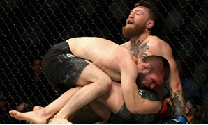 Khabib Nurmagomedov of Russia holds down Conor McGregor of Ireland in their UFC lightweight championship on October 6, where a post-match brawl broke out between the two fighters and their entourages