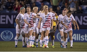 Oct 14, 2018; Frisco, TX, USA; United States midfielder Lindsey Horan (9) and Tobin Heath (17) and Abby Dahlkemper (7) and Becky Sauerbrunn (4) and Kelley O'Hara (5) celebrate a goal by Heath against Jamaica during the first half of a 2018 CONCACAF Women'