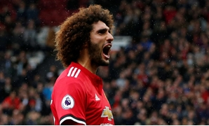 Manchester United's Marouane Fellaini celebrates scoring their third goal REUTERS/Andrew Yates