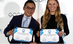 Tennis player Caroline Wozniacki attends a signing ceremony with CEO of GCOX Global Crypto Offering Exchange, Jeffrey Lin, to launch her own cryptocurrency in Singapore October 18, 2018. REUTERS/Edgar Su