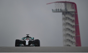 On top: Lewis Hamilton in practice on Friday