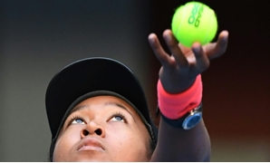 Naomi Osaka serves during her semi-final against Anastasija Sevastova of Latvia at the China Open