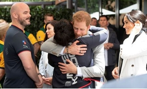 Britain's Prince Harry and Meghan, the Duchess of Sussex meet Team UK competitors while attending a lunchtime Reception hosted by the Prime Minister with Invictus Games competitors, their family and friends in the city's central parkland Sydney October 21