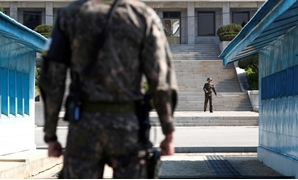FILE PHOTO: A North Korean soldier patrols at the truce village of Panmunjom inside the demilitarized zone (DMZ) separating the two Koreas, South Korea, April 18, 2018. Picture taken on April 18, 2018. REUTERS/Kim Hong-Ji