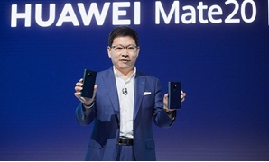 FILE- Huawei Consumer Business Group (BG) unveils the HUAWEI Mate 20 Series, one of the most highly anticipated smartphone series of the year