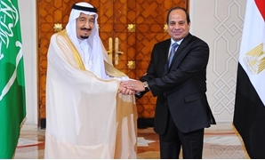 FILE - Egyptian President Abdel Fatah al-Sisi (R) with Saudi King Salman