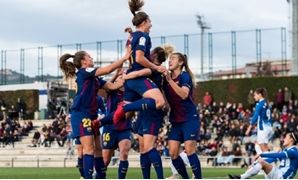 FILE - Barcelona women's team celebrates scoring against Espanyol at Catalan Derby