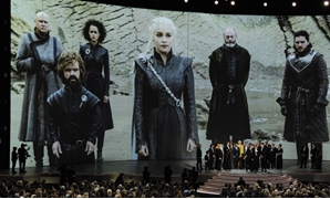 "FILE - ""Game of Thrones"" cast and crew members accept the Emmy Award for"