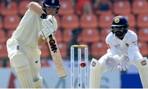 © AFP | England's Rory Burns (L) plays a shot as Sri Lanka's wicketkeeper Niroshan Dickwella looks on during the first day of the second Test match between Sri Lanka and England at the Pallekele International Cricket Stadium in Kandy on November 14, 2018.