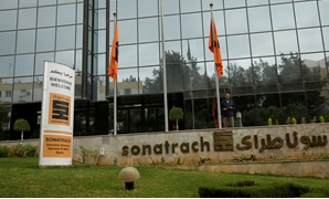 FILE PHOTO: An employee stands near the headquarter of the state energy company Sonatrach in Algiers