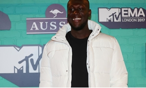 FILE PHOTO: British Hip Hop artist Stormzy arrives at the 2017 MTV Europe Music Awards at Wembley Arena in London, Britain, November 12, 2017. REUTERS/Hannah McKay/File Photo