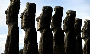"FILE PHOTO: A view of ""Moai"" statues in Ahu Akivi, on Easter Island, 4,000 km (2,486 miles) west of Santiago, in this photo taken Oct. 31, 2003. REUTERS/Carlos Barria/File Photo