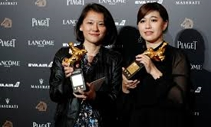 "Taiwan's director Yue Fu (R) poses backstage after winning Best Documentary for her movie ""Our Youth in Taiwan"" at the 55th Golden Horse Awards in Taipei, Taiwan November 17, 2018. REUTERS/Tyrone Siu"