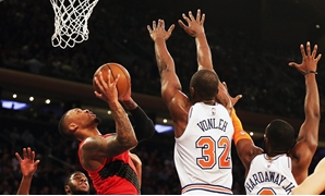 Nov 20, 2018; New York, NY, USA; Portland Trail Blazers guard Damian Lillard (0) shoots against New York Knicks forward Noah Vonleh (32) during the second half at Madison Square Garden. Mandatory Credit: Andy Marlin-USA TODAY Sports