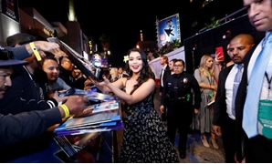 "FILE PHOTO: Cast member Auli'i Cravalho signs autographs at the premiere for the movie ""Ralph Breaks the Internet"" at El Capitan theatre in Los Angeles, California, U.S., November 5, 2018. REUTERS/Mario Anzuoni."
