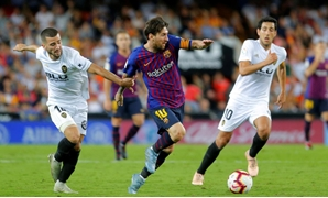 Soccer Football - La Liga Santander - Valencia v FC Barcelona - Mestalla, Valencia, Spain - October 7, 2018 Barcelona's Lionel Messi in action with Valencia's Jose Gaya REUTERS/Heino Kalis
