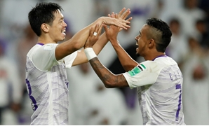 Soccer Football - Club World Cup - Al-Ain v Team Wellington - Hazza bin Zayed Stadium, Al Ain, United Arab Emirates - December 12, 2018 Al-Ain's Tsukasa Shiotani and Caio celebrate winning the shootout REUTERS/Andrew Boyers