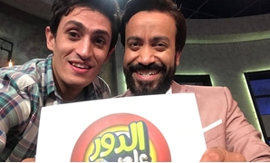 "Sameh Hussein (R) and Ahmed Baseem (L) holding 'Al Dour AlaMeen"" poster"
