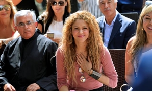 FILE PHOTO: Colombian singer Shakira reacts during her visit to Tannourine Cedars Reserve, in Tannourine, Lebanon July 13, 2018. REUTERS/Jamal Saidi.