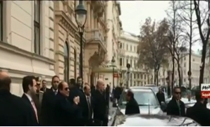 President Abdel Fatah al-Sisi waves back at expats greeting him in front of his residence in Vienna, Austria. December 16, 2018. TV screenshot.