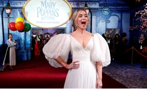 FILE PHOTO: Cast member Emily Blunt reacts on the red carpet at the world premiere of Disney's movie Mary Poppins Returns in Los Angeles, California, U.S., November 29, 2018. REUTERS/Mario Anzuoni/File Photo.