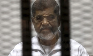 FILE - Morsi in a trial session