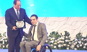 FILE - President Sisi honors a disabled person, July, 30, 2018 – Courtesy of the presidency