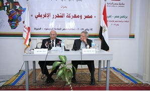 Head of the National Council for Human Rights Mohamed Fayek (L) and Misr Public Library Director Abdel Raouf el-Reidy - Press photo