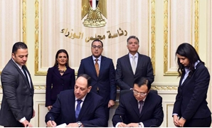 Chairman of the National Authority for Tunnels Ahmed Fouda and EXIM Deputy Vice-President Xie Ping sign $1.2 billion agreement to fund electric train connecting Salam City and the New Administrative Capital in Cairo, Egypt. January 16, 2019. Press Photo