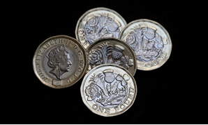 FILE PHOTO: New one pound coins, which come into circulation today, are seen in London, Britain March 28, 2017. REUTERS/Neil Hall