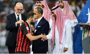 Soccer Football - Italian Super Cup - Juventus v AC Milan - King Abdullah Sports City, Jeddah, Saudi Arabia - January 16, 2019 AC Milan's Gonzalo Higuain looks on as he receives a medal after the match REUTERS/Waleed Ali