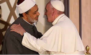 FILE: Sheikh Ahmad el Tayyeb and Pope Francis
