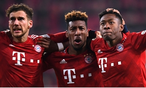 Soccer Football - Bundesliga - FC Augsburg v Bayern Munich - WWK Arena, Augsburg, Germany - February 15, 2019 Bayern Munich's David Alaba celebrates scoring their third goal with Kingsley Coman and Leon Goretzka REUTERS/Andreas Gebert DFL regulations proh