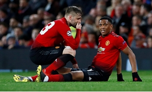 FILE PHOTO: Manchester United's Anthony Martial after sustaining an injury, with Luke Shaw Old Trafford, Manchester, Britain - Feb 12, 2019. Action Images via Reuters/Jason Cairnduff/File Photo