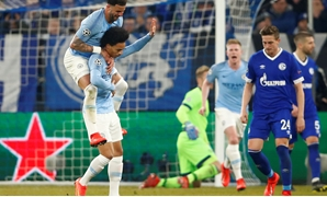 Soccer Football - Champions League - Round of 16 First Leg - Schalke 04 v Manchester City - Veltins-Arena, Gelsenkirchen, Germany - February 20, 2019 Manchester City's Leroy Sane celebrates scoring their second goal with Kyle Walker REUTERS/Wolfgang Ratta