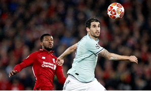 Soccer Football - Champions League - Round of 16 First Leg - Liverpool v Bayern Munich - Anfield, Liverpool, Britain - February 19, 2019 Bayern Munich's Javi Martinez in action with Liverpool's Georginio Wijnaldum Action Images via Reuters/Carl Recine