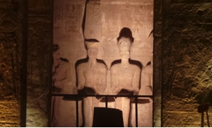 Sun illuminates four statues of King Ramses II seated at the top of Abu Simbel temple- Egypt TodayAbdullah Salah