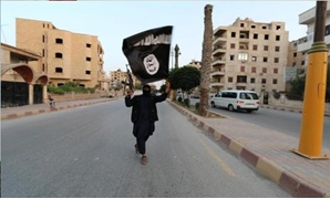 A member loyal to the Islamic State Reuters